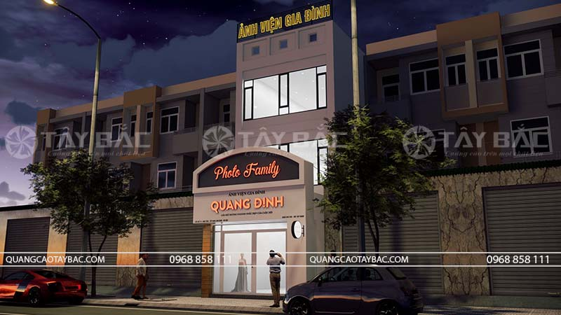 Biển mặt tiền tiệm ảnh Quanh Định vào buổi tối